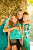 Mother with son adn daughter on a walk in park. In late summer afternoon stock photography