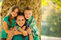 Mother with son adn daughter on a walk in park. In late summer afternoon Royalty Free Stock Photography