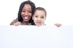 Mother and son african american boy. A mother and son african american boy holding a white card Stock Photos