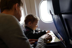 Mother with son in aircraft Royalty Free Stock Photo