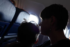 Mother with son at airplane Royalty Free Stock Photos