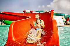 Mother and son in aqua-park. Mother and son having fun in aqua-park Royalty Free Stock Photography