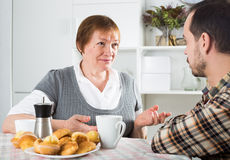 Mother and son arguing. Mature mother having disagreement with adult son at home Stock Photos