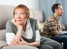 Mother and son arguing. Mature mother having disagreement with adult son at home Royalty Free Stock Photography