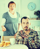 Mother and son arguing. Mature mother having disagreement with adult son at home Stock Photo