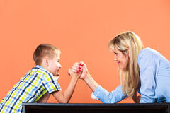 Mother and son arm wrestling. Royalty Free Stock Photos