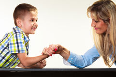 Mother and son arm wrestling. Stock Images