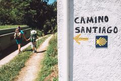 Mother and son as a pilgrims walk on St.Santiago Way, North Spain