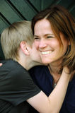 Mother and son. Attractive mother and her teenager son having secrets Stock Image