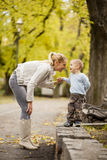 Mother and son in the autumn forest royalty free stock photography