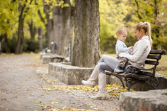 Mother and son in the autumn forest stock images
