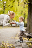 Mother and son in the autumn forest stock image