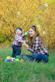 Mother and son in autumn forest. Mom and son playing in the autumn forest royalty free stock photography