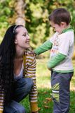 Mother and son in autumn park. Happy mother and son in autumn park royalty free stock photos