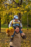 Mother and son in autumn park Royalty Free Stock Photography