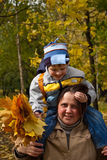 Mother and son in autumn park Royalty Free Stock Photos