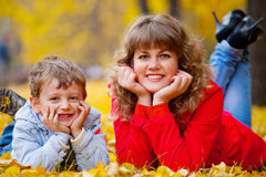 Mother with son in the autumn park Royalty Free Stock Photography