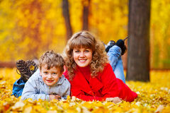 Mother with son in the autumn park Royalty Free Stock Photos