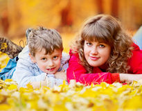 Mother with son in the autumn park Royalty Free Stock Images