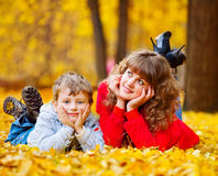 Mother with son in the autumn park Stock Photos