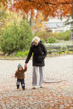 Mother and son in at autumn park.  Royalty Free Stock Images
