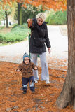 Mother and son in at autumn park Stock Photography