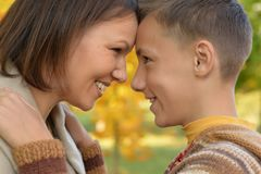 Mother with son in autumn park Royalty Free Stock Photo