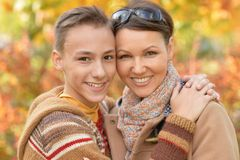 Mother with son in autumn park. Beautiful mother with son in autumn park stock photo