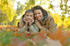 Mother with son in autumn park. Beautiful mother with son in autumn park Royalty Free Stock Photography