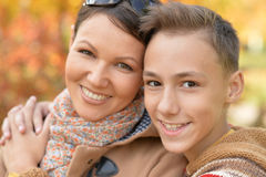 Mother with son in autumn park Stock Images