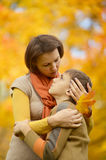 Mother with son in autumn park. Beautiful mother with son in autumn park Royalty Free Stock Images