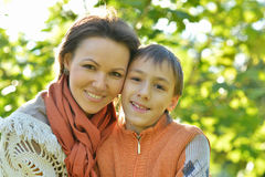 Mother with son in autumn park. Beautiful mother with son in autumn park Stock Image