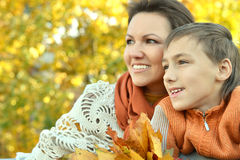 Mother with son in autumn park. Beautiful mother with son in autumn park Stock Photos