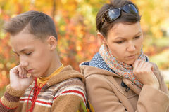 Mother with son in autumn park. Beautiful sad mother with son in autumn park Royalty Free Stock Photography