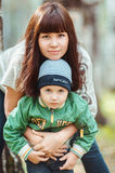 Mother with son in autumn park, happy family Royalty Free Stock Photography