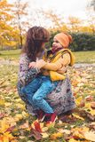Mother and son in autumn park outdoor. Mum and son together royalty free stock photography