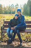 Mother and son at autumn park. In sunny beauty day stock photo