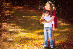 Mother and son in autumn Royalty Free Stock Image