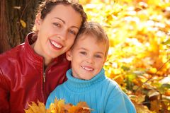 Mother and son in autumn wood royalty free stock images