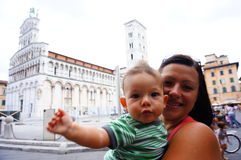 Mother and son. Mother and baby at a square in Lucca, Italy Royalty Free Stock Photos