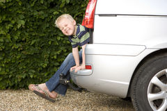 Mother and son (4-6) in back of car, smiling, portrait Royalty Free Stock Photos