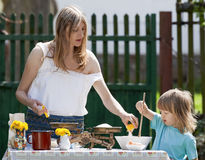 Mother and son baking. In the garden Royalty Free Stock Photography