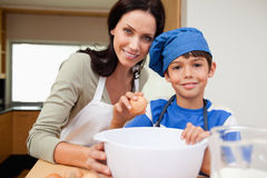 Mother and son baking cake. Together stock photo