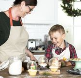 Mother and son baking before Christmas stock photography