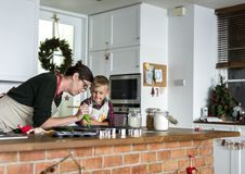 Mother and son baking for Christmas in the kitchen royalty free stock images
