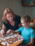 Mother and son baking cookies. Mother and son making gingerbread cookies Royalty Free Stock Photos
