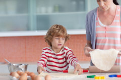 Mother and son Baking in the Kitchen. Young Mother with her son Baking in the Kitchen Royalty Free Stock Image
