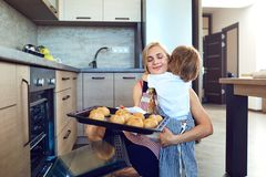 Mother and son with baking in the kitchen indoors.  royalty free stock photos