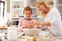 Mother and son baking together at home Stock Photo