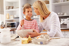 Mother and son baking together at home Royalty Free Stock Image